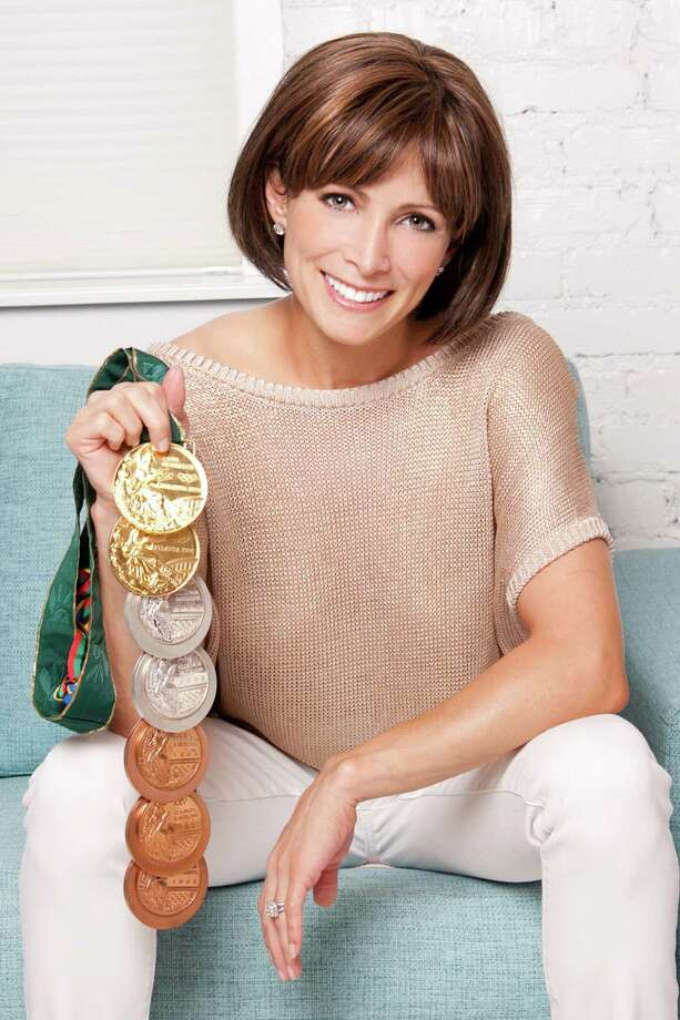 Former world-champion gymnast and cancer survivor Shannon Miller displays her seven Olympic medals. Miller, who beat a rare form of ovarian cancer, will speak in Fairfield March 20 at a program to benefit a Southport cancer-survivorship center. Photo: Contributed Photo / Fairfield Citizen contributed