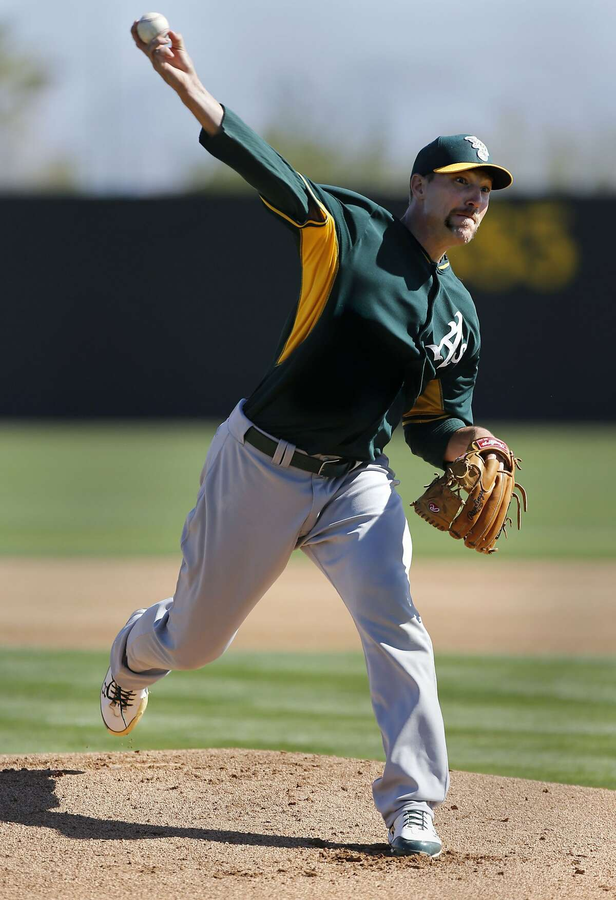 A's pitcher Jim Johnson, (45) throws during batting practice at the Papago Baseball facility in Phoenix, Arizona on Monday Feb. 24, 2014. The Oakland Athletics continue their spring training schedule in the Arizona desert in preparation for the 2014 MBL season.