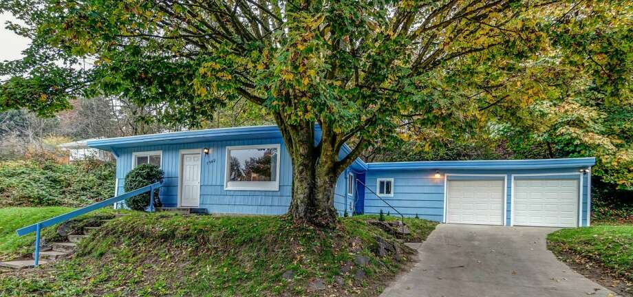 We'll start with the highest-priced home on our tour, 7542 21st Ave. S.W. The 1,800-square-foot house, built in 1949, has four bedrooms, two bathrooms, a family room and a two-car garage on a 9,400-square-foot lot. It's listed for $248,000. An open house is scheduled for 1 p.m. to 3 p.m. on Saturday. Photo: Diana Kallerson/Courtesy Margaret Berg, Coldwell Banker Danforth