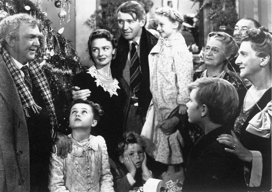 "James Stewart (center) and Donna Reed (third from left) in the last scene of ""It's a Wonderful Life."" Photo: Anonymous, Associated Press"
