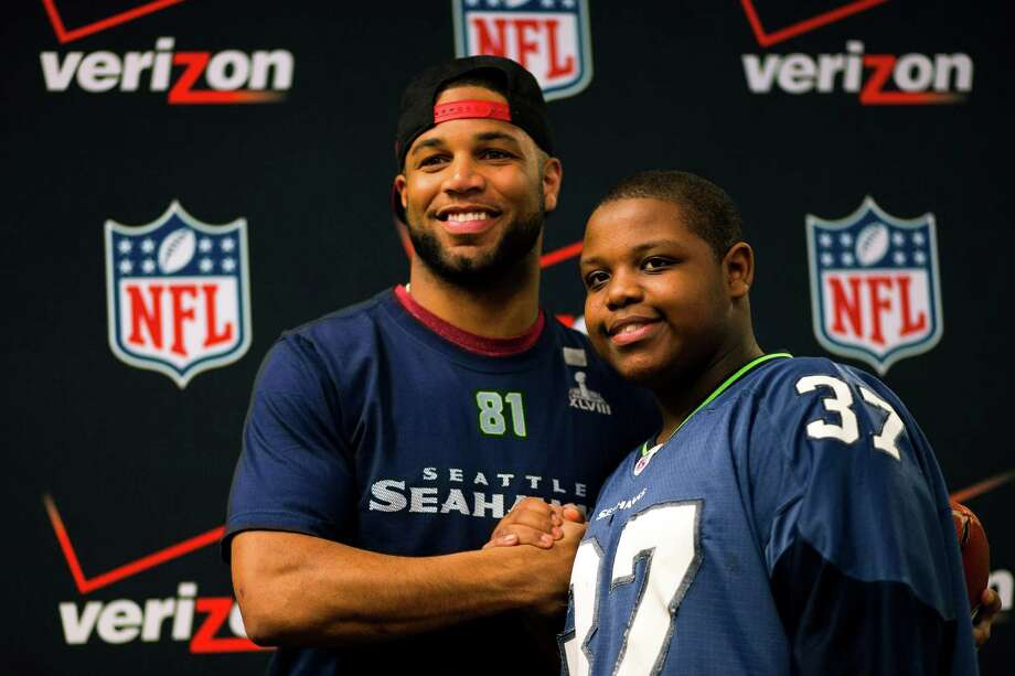 "Seahawks wide receiver Golden Tate appears at Auburn Riverside High School after the institution won the Verizon-sponsored second annual ÒSave It SeattleÓ contest Thursday, Feb. 27, 2014, in Auburn. The ""Save It Seattle"" movement encourages the community to take a pledge to stop texting and driving. Quarterback Russell Wilson was the guest last year after Seattle's Roosevelt High School won the contest. Photo: JORDAN STEAD, SEATTLEPI.COM / SEATTLEPI.COM"
