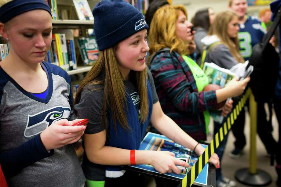 "Auburn Riverside High School students wait to get autographs by Seahawks wide receiver Golden Tate for the Verizon-sponsored second annual ÒSave It SeattleÓ contest Thursday, Feb. 27, 2014, in Auburn. The ""Save It Seattle"" movement encourages the community to take a pledge to stop texting and driving. Quarterback Russell Wilson was the guest last year after Seattle's Roosevelt High School won the contest. Photo: JORDAN STEAD, SEATTLEPI.COM / SEATTLEPI.COM"