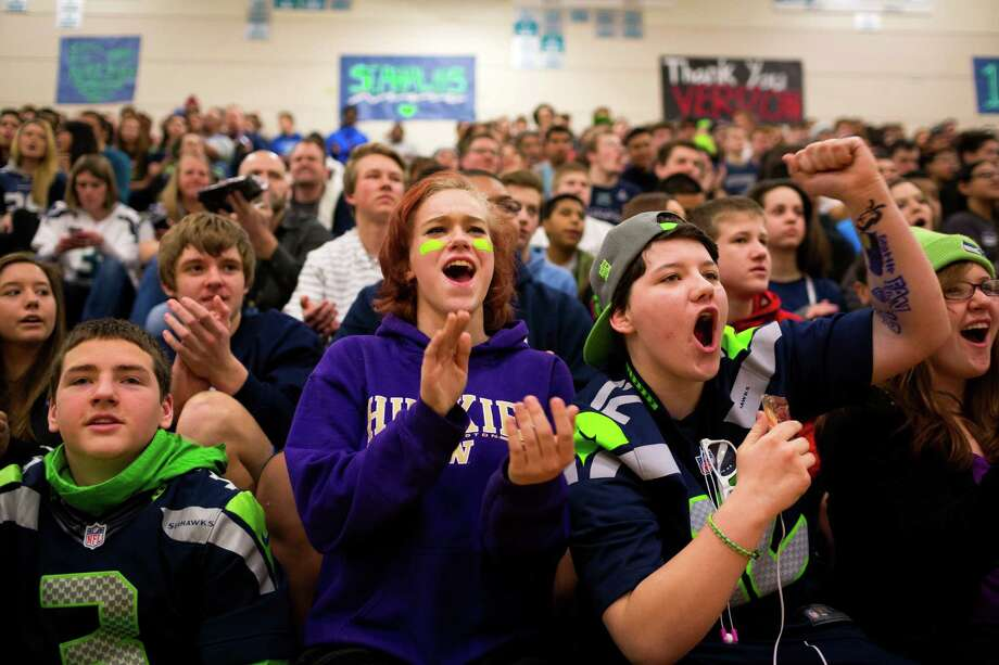 "Auburn Riverside High School students scream for the arrival of Seahawks wide receiver Golden Tate for the Verizon-sponsored second annual ÒSave It SeattleÓ contest Thursday, Feb. 27, 2014, in Auburn. The ""Save It Seattle"" movement encourages the community to take a pledge to stop texting and driving. Quarterback Russell Wilson was the guest last year after Seattle's Roosevelt High School won the contest. Photo: JORDAN STEAD, SEATTLEPI.COM / SEATTLEPI.COM"