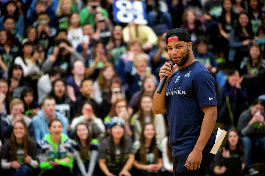 "Seahawks wide receiver Golden Tate, right, speaks to the student body during an assembly at Auburn Riverside High School after the institution won the Verizon-sponsored second annual ÒSave It SeattleÓ contest Thursday, Feb. 27, 2014, in Auburn. The ""Save It Seattle"" movement encourages the community to take a pledge to stop texting and driving. Quarterback Russell Wilson was the guest last year after Seattle's Roosevelt High School won the contest. Photo: JORDAN STEAD, SEATTLEPI.COM / SEATTLEPI.COM"