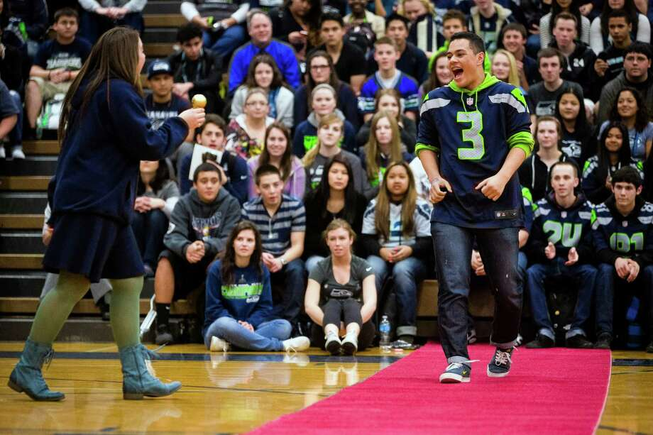 "Auburn Riverside High School students accept ""Golden"" Globes trophies during the Verizon-sponsored second annual ÒSave It SeattleÓ contest Thursday, Feb. 27, 2014, in Auburn. The ""Save It Seattle"" movement encourages the community to take a pledge to stop texting and driving. Quarterback Russell Wilson was the guest last year after Seattle's Roosevelt High School won the contest. Photo: JORDAN STEAD, SEATTLEPI.COM / SEATTLEPI.COM"