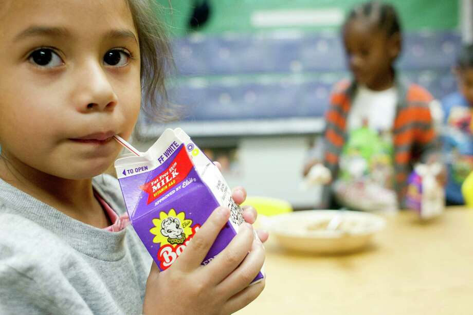 Mirna Franco, 3, sips on her milk as children ages 3-5 eat tofu and sweet potato french fries for lunch at the Harris County Department of Education Head Start program in the 5th Ward Multiservice Center Thursday, Feb. 27, 2014, in Houston. Through the Child and Adult Care Food Program, this Head Start facility is able to provide children with healthy balanced lunches. Photo: Johnny Hanson, Houston Chronicle / © 2014  Houston Chronicle