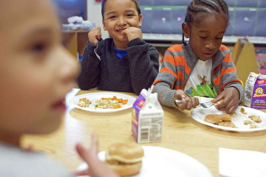 From left, Alexandra Vargas, 5, Victor Pedrajo, 4, and Junior Guity-Valencia, 4, eat tofu and sweet potato french fries for lunch at the Harris County Department of Education Head Start program in the 5th Ward Multiservice Center Thursday, Feb. 27, 2014, in Houston. Through the Child and Adult Care Food Program, this Head Start facility is able to provide children with healthy balanced lunches. Photo: Johnny Hanson, Houston Chronicle / © 2014  Houston Chronicle