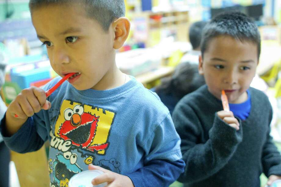Alejandro Mora, 3, left, and Victor Pedrajo, 4, brush their teeth they ate tofu and sweet potato french fries for lunch at the Harris County Department of Education Head Start program in the 5th Ward Multiservice Center. Photo: Johnny Hanson, Houston Chronicle / © 2014  Houston Chronicle