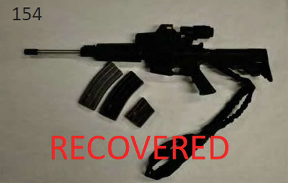 An AR-15-style rifle recovered during the investigation into burglaries committed by Donovan Smith and Brandi Campbell, pictured in a Justice Department photo. Photo: Justice Department Photos