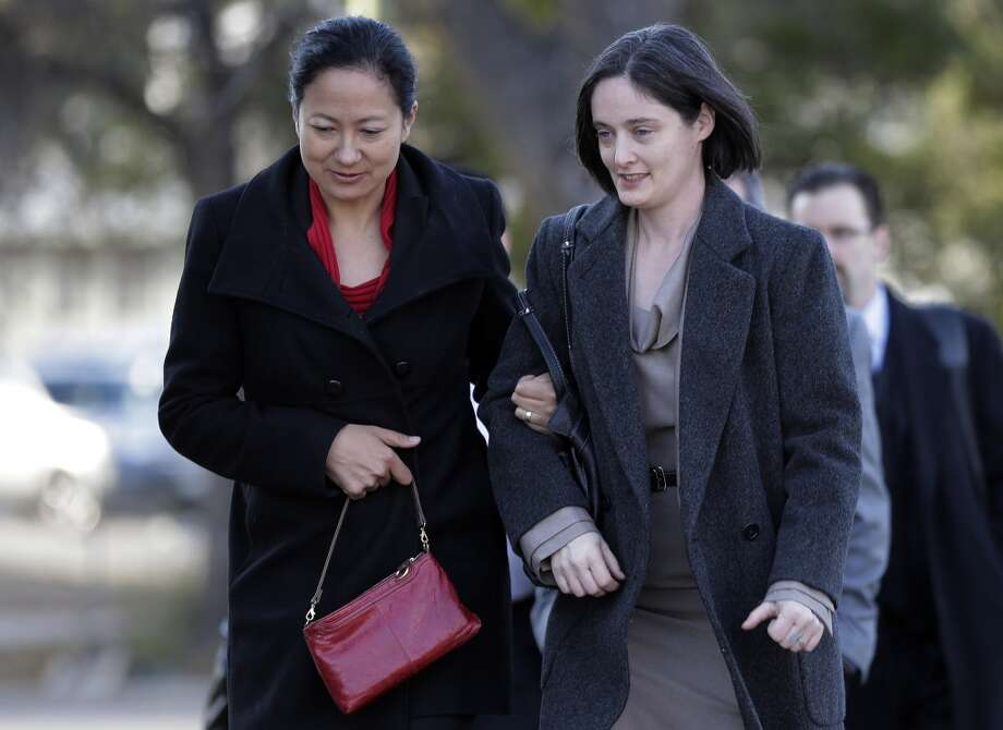 Cleopatra De Leon, left, and partner, Nicole Dimetman, right, arrive at the U.S. Federal Courthouse, Wednesday,  Feb. 12, 2014, in San Antonio, where a federal judge is expected to hear arguments in a lawsuit challenging Texas' ban on same-sex marriage. (AP Photo/Eric Gay) Photo: Associated Press