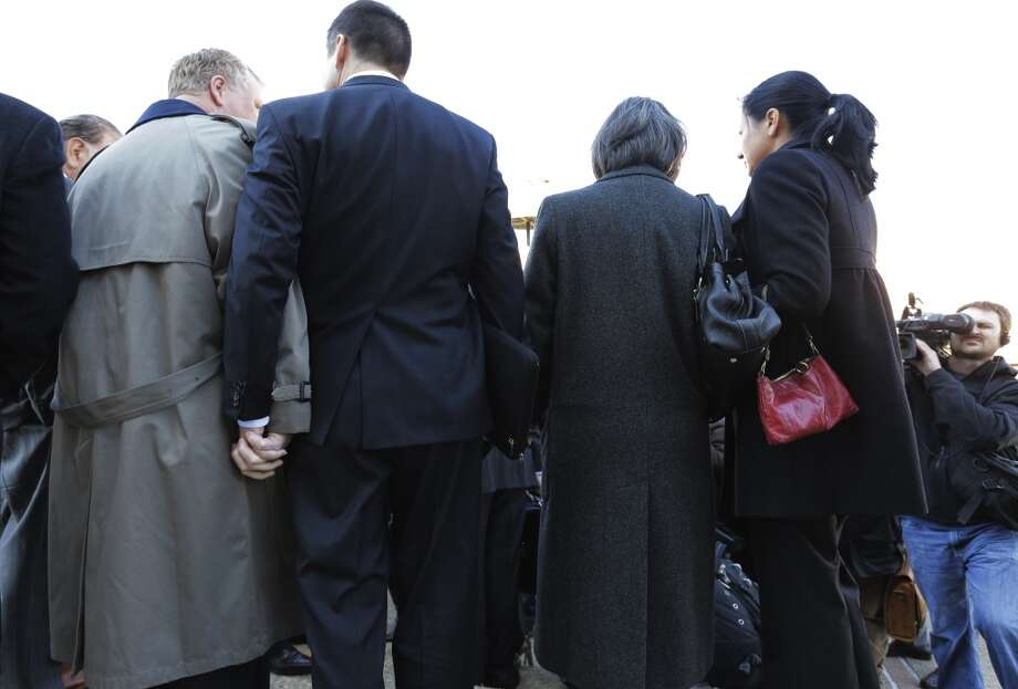 Mark Phariss, left, clutches the hand of partner Victor Holmes, right, as they stand with Cleopatra De Leon, second from right, and her partner, Nicole Dimetman, right, as they talk with the media after as they leave the U.S. Federal Courthouse, Wednesday,  Feb. 12, 2014, in San Antonio.  The two couples are challenging Texas' ban on same-sex marriage and have taken their case to federal court. (AP Photo/Eric Gay) Photo: Associated Press
