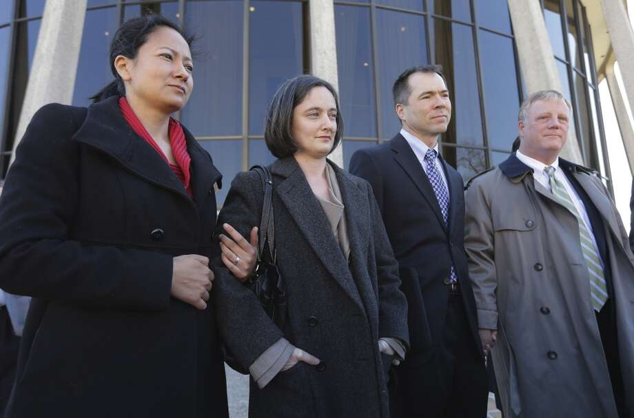 Couples Cleopatra De Leon, left, and partner, Nicole Dimetman, second from left, and Victor Holmes and partner Mark Phariss, right, talk with the media after as they leave the U.S. Federal Courthouse, Wednesday,  Feb. 12, 2014, in San Antonio. The two homosexual couples are challenging Texas' ban on same-sex marriage and have taken their case to federal court. (AP Photo/Eric Gay) Photo: Associated Press