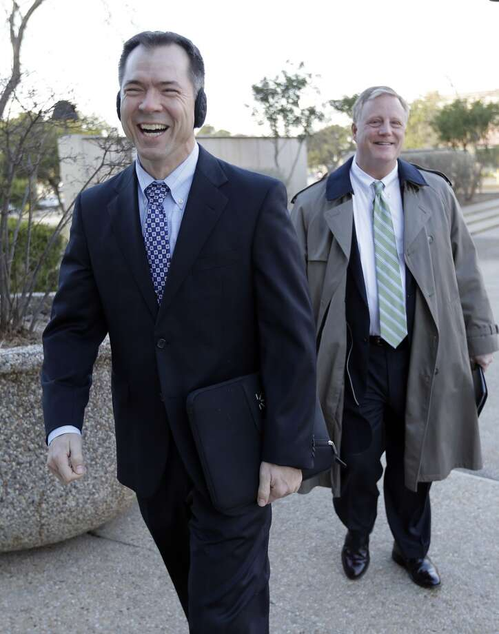 Victor Holmes, left, and partner Mark Phariss, right, arrive at the U.S. Federal Courthouse, Wednesday,  Feb. 12, 2014, in San Antonio, where a federal judge is expected to hear arguments in a lawsuit challenging Texas' ban on same-sex marriage. (AP Photo/Eric Gay) Photo: Associated Press