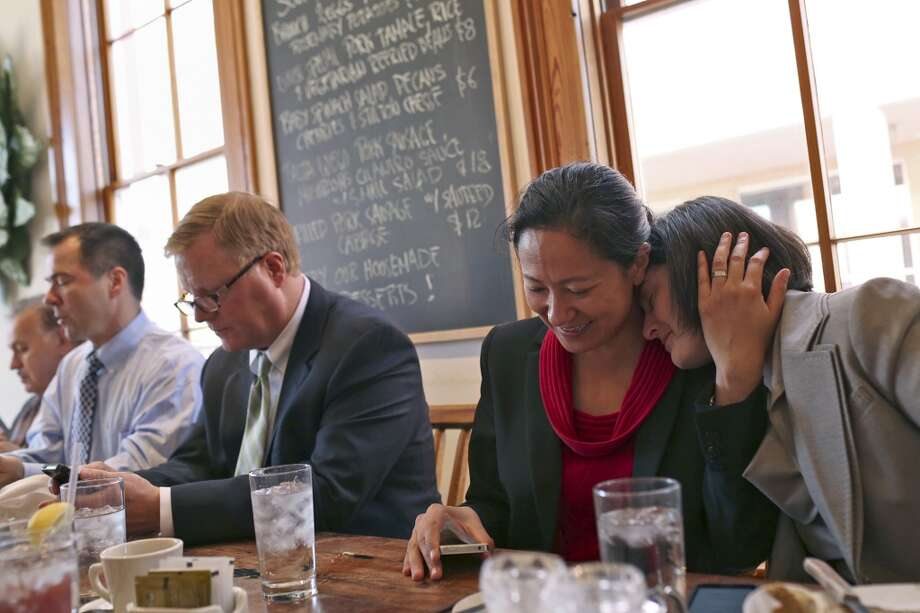 Nicole Dimetman, right, relaxes with her wife, Cleo DeLeon, as they have lunch with fellow plaintiffs Mark Phariss and his partner, Victor Holmes, far left, as they have lunch with their legal team at Liberty Bar after the hearing for their request for a preliminary injunction to declare Texas' ban on same-sex marriage unconstitutional at the John H. Wood, Jr. U.S. Courthouse in San Antonio on Wednesday, Feb. 12, 2014. Photo: SAN ANTONIO EXPRESS-NEWS