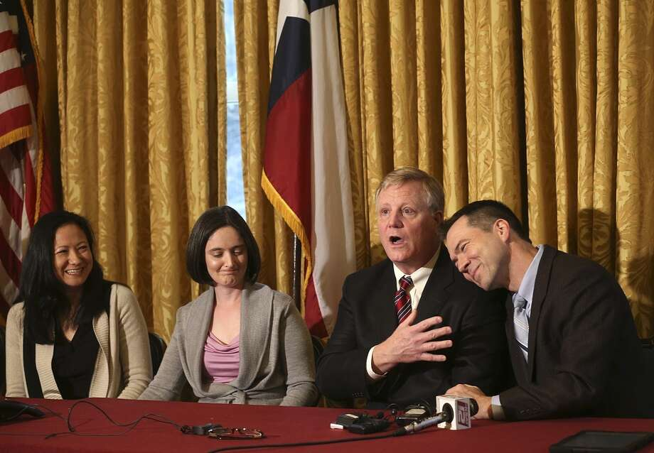 Gay couples from left, Cleopatra De Leon, Nicole Dimetman, Mark Phariss and Victor Holmes, react at a press conference after U.S. Federal Judge Orlando Garcia granted a preliminary injunction after they sued the state of Texas couples to strike down the gay marriage ban, Wednesday, Feb. 26, 2014. Photo: San Antonio Express-News