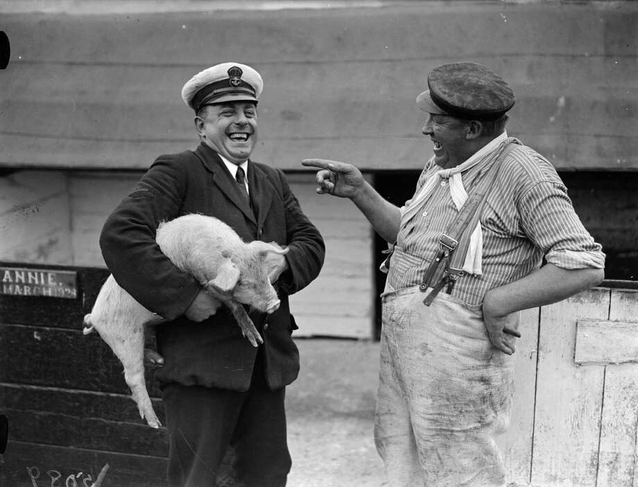 March 1 is National Pig Day, so let's take a look at our favorite barnyard animal, the lowly pig.Above, a man an his pig, 1927. Photo: Fox Photos, Getty Images / Hulton Archive