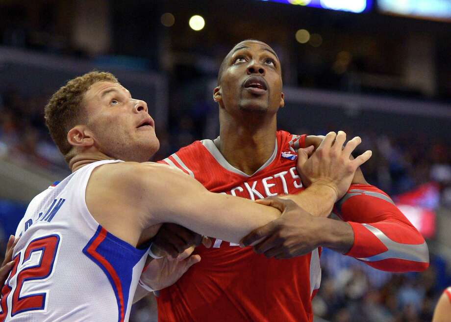 Banging heads with the likes of Blake Griffin, left, will become a more frequent occurrence for Dwight Howard in March than it was in January or February, which ended with a loss to the Clippers on Wednesday. Photo: Mark J. Terrill, STF / AP
