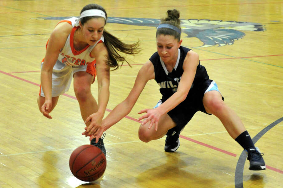 Danbury's Rachel Gartner and Wilton's Makenna Pearsall compete for the loose ball during their FCIAC championship basketball game at Fairfield Ludlowe High School in Fairfield, Conn., on Thursday, Feb. 27, 2014. Danbury won, 41-29. Photo: Jason Rearick / Stamford Advocate
