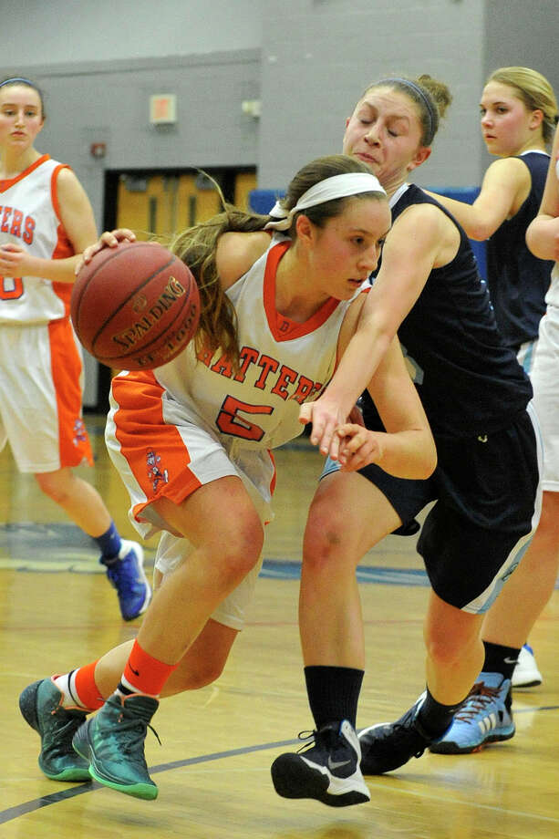 Danbury's Rachel Gartner drives past Wilton's Makenna Pearsall during their FCIAC championship basketball game at Fairfield Ludlowe High School in Fairfield, Conn., on Thursday, Feb. 27, 2014. Danbury won, 41-29. Photo: Jason Rearick / Stamford Advocate