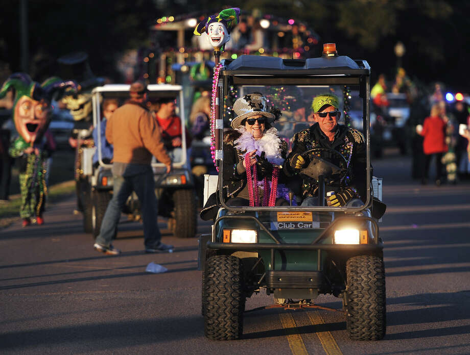 Barb and Mike Milstead participate in Thursday afternoon's parade in Port Arthur. Port Arthur held the Courir du Mardi Gras Parade along Lakeshore Drive on Thursday night. The small parade acts as one of the opening ceremonies of Mardi Gras in the city. Photo taken Thursday, 2/27/14 Jake Daniels/@JakeD_in_SETX Photo: Jake Daniels / ©2014 The Beaumont Enterprise/Jake Daniels
