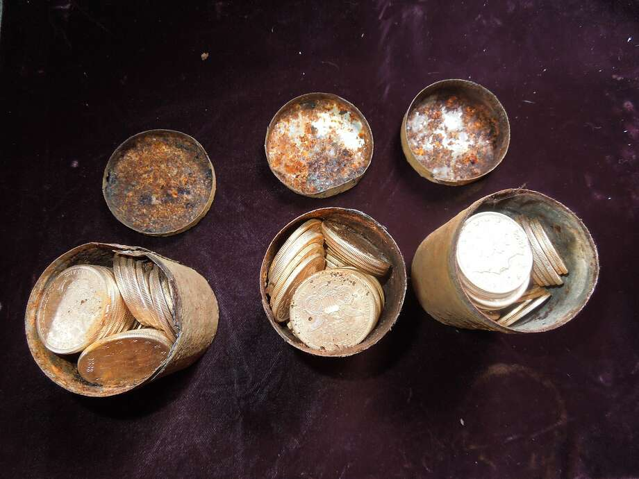 A Northern California couple says they discovered cans filled with 19th century gold coins - 1,427 of them - on their property. Photo: Handout, AFP/Getty Images