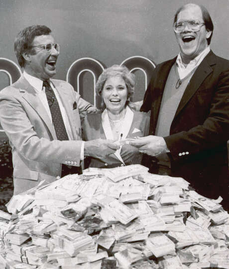 "File-This Jan. 16, 1986. file photo shows host Jim Lange, left, congratulating Connie and Steve Rutenbar of Mission Viejo, Calif., after they won $1 million on the TV show "" The $1,000,000 Chance of a Lifetime"".  Lange, the first host of the popular game show ""The Dating Game,"" has died at his home in Mill Valley, Calif. He was 81. He died Tuesday morning after suffering a heart attack, his wife Nancy told The Associated Press Wednesday, Feb. 26, 2014. (AP Photo/File) Photo: STF / AP"
