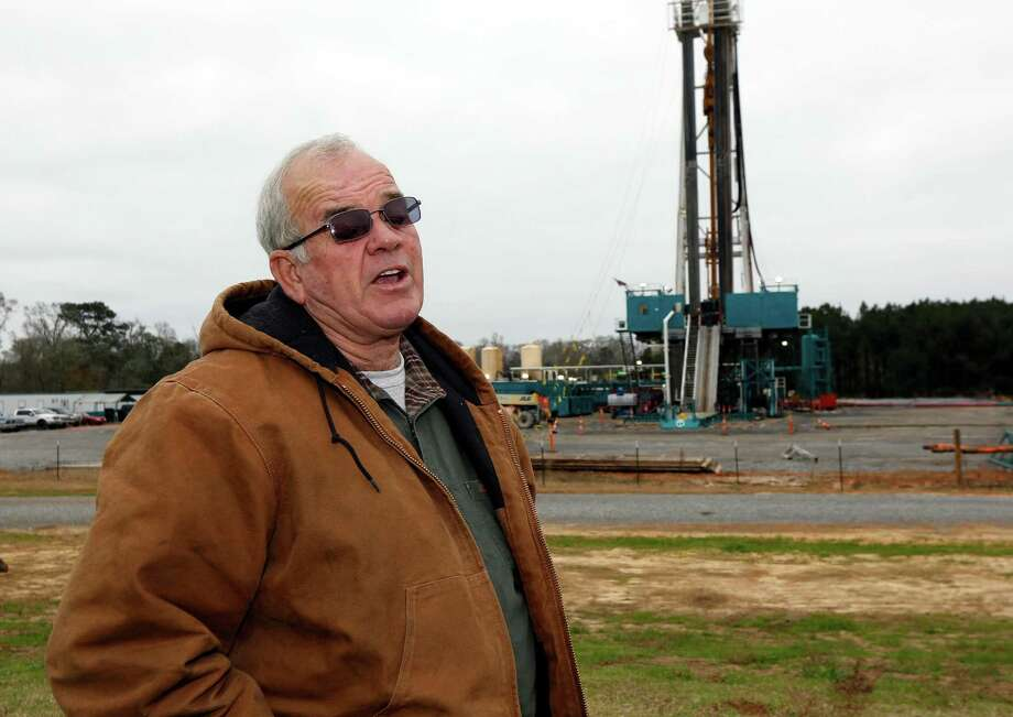 "Encana Corp. is looking for oil in Max Lawson's back pasture near Gillsburg, Miss. ""They call it the Gillsburg Christmas tree,"" he said. ""It looks like a little city over here at night."" Photo: Rogelio V. Solis, STF / AP"