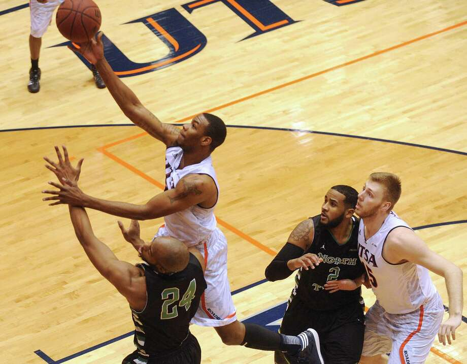 Phillip Jones of UTSA shoots over Kelvin Gaines of North Texas during college basketball action at the UTSA Convocation Center on Thursday, Feb. 27, 2014. Photo: Billy Calzada, San Antonio Express-News / San Antonio Express-News