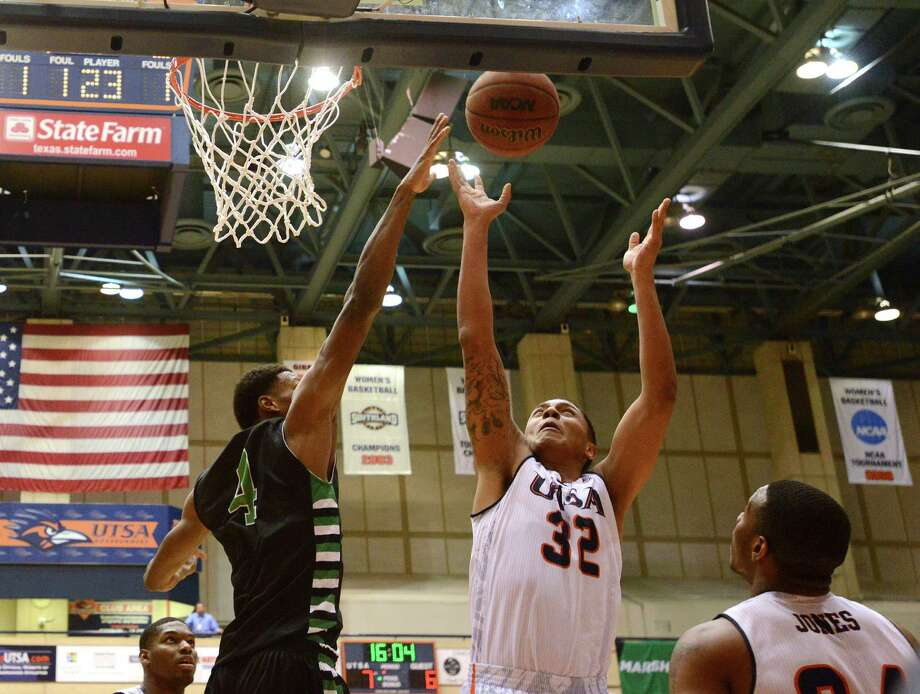 Jordan Sims of UTSA (32) shoots over Armani Flannigan of North Texas during college basketball action at the UTSA Convocation Center on Thursday, Feb. 27, 2014. Photo: Billy Calzada, San Antonio Express-News / San Antonio Express-News
