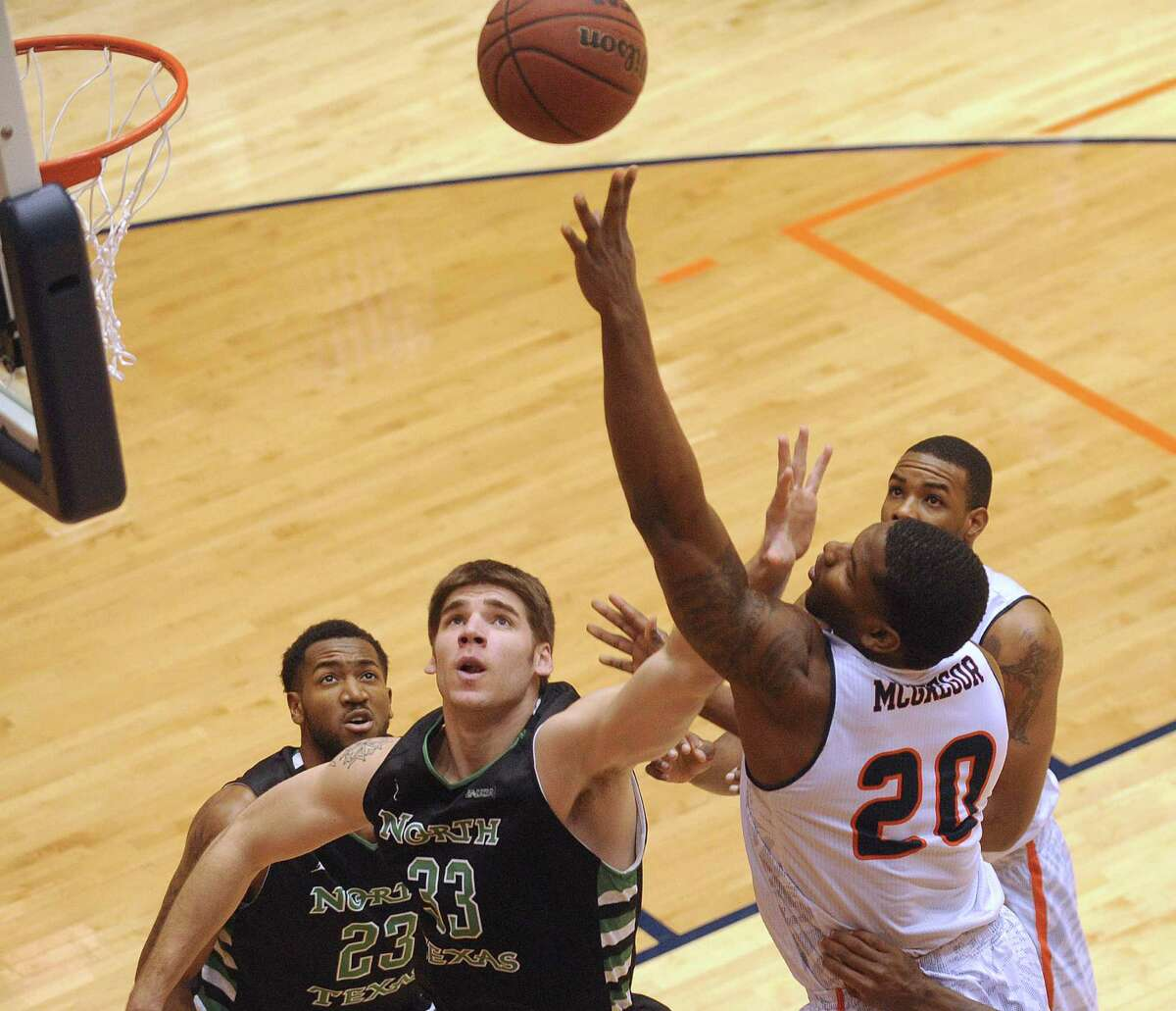 UTSA's Edrico McGregor shoots as Colin Voss of North Texas defends during college basketball action at the UTSA Convocation Center on Thursday, Feb. 27, 2014.