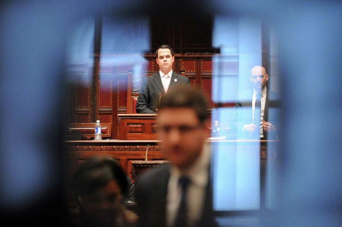 Senator David Carlucci, center, 38th district, looks over the NYS Senate floor during session at the Capitol on Thursday Feb. 27, 2014 in Albany, N.Y. (Michael P. Farrell/Times Union)