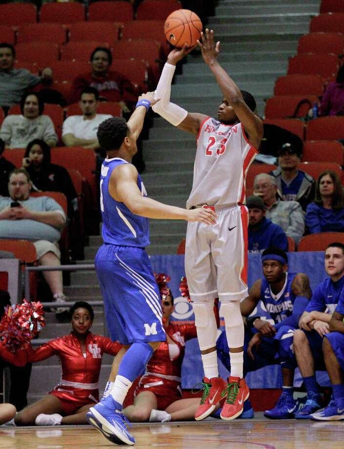 Houston's forward Danuel House (23) shoots a three-point shot against Memphis during the first half of an NCAA college basketball game, Thursday, Feb. 27, 2014, in Houston. (AP Photo/Bob Levey) Photo: BOB LEVEY, Associated Press / FR156786 AP