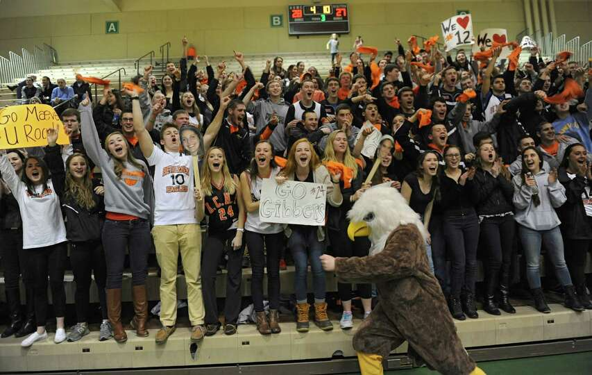 Bethlehem fans cheer for their team during the Class AA girls' basketball semifinal against Albany a