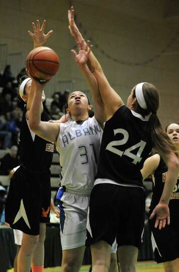 Albany's Ariel Greer goes up for a basket during the Class AA girls' basketball semifinal against Be