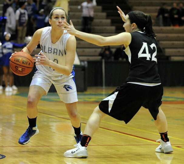 Albany's Cara Waterson is guarded by Bethlehem's Kylie McKenna during the Class AA girls' basketball