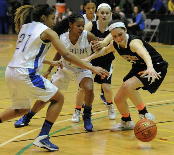 Bethlehem's Jenna Giacone battle for the ball with Albany's Cyla Wilson, left, and Mylah Chandler, c