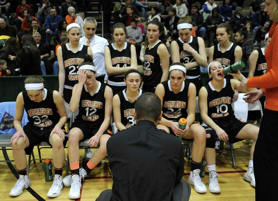 Bethlehem head coach Matthew Bixby talks to his team during a time out in the Class AA girls' basketball semifinal against Albany at Hudson Valley Community College on Thursday, Feb. 27, 2014 in Troy, N.Y.  (Lori Van Buren / Times Union) Photo: Lori Van Buren / 00025932A