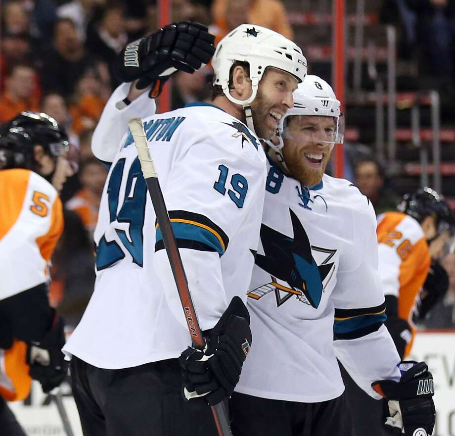 The San Jose Sharks' Joe Pavelski celebrates his second-period hat trick goal with teammate Joe Thornton (19) against the Philadelphia Flyers at the Wells Fargo Center in Philadelphia on Thursday, Feb. 27, 2014. (Yong Kim/Philadelphia Daily News/MCT) Photo: Yong Kim, McClatchy-Tribune News Service