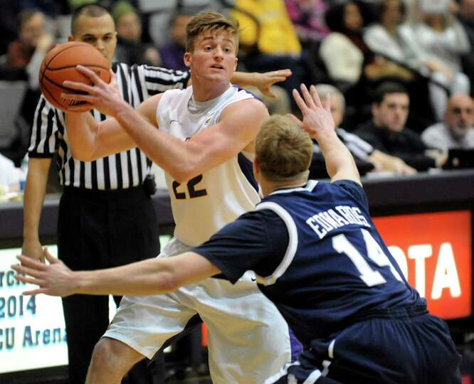 UAlbany's Dave Wiegmann, left, looks to pass as New Hampshire's John Edwards defends during their ba