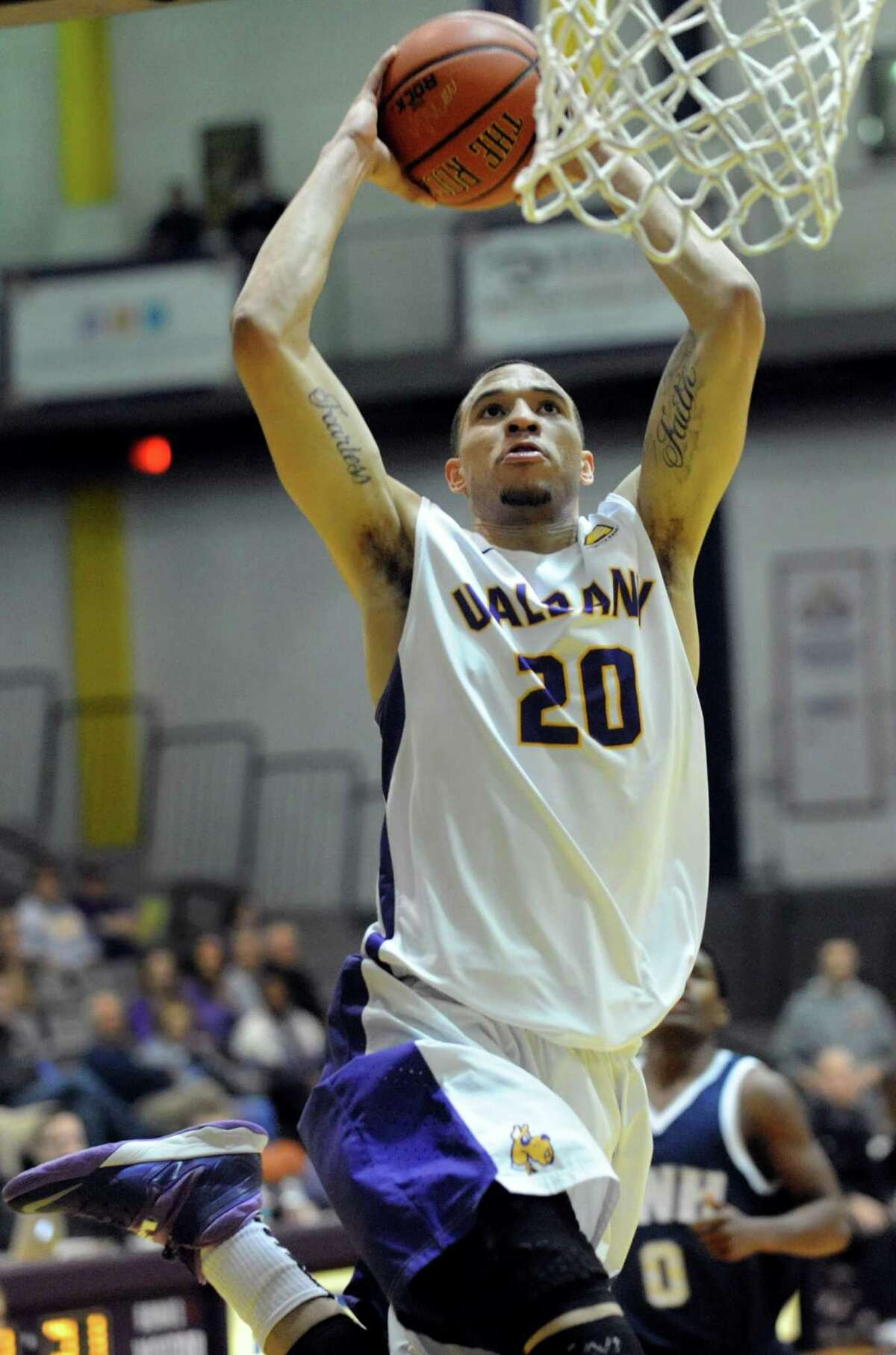 UAlbany's Gary Johnson goes to the hoop during their basketball game against New Hampshire on Thursday, Feb. 27, 2014, UAlbany in Albany, N.Y. (Cindy Schultz / Times Union)
