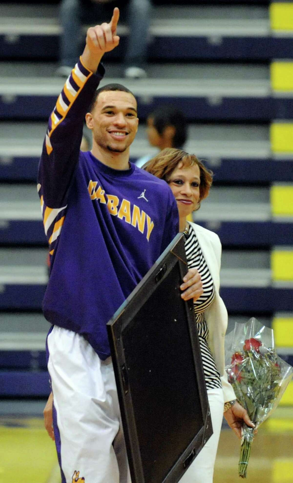 UAlbany's Gary Johnson salutes his fans as he celebrates senior night before their basketball game against New Hampshire on Thursday, Feb. 27, 2014, UAlbany in Albany, N.Y. (Cindy Schultz / Times Union)