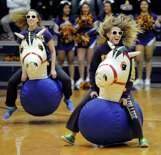 UAlbany students race on bouncy horses during a break in their basketball game against New Hampshire
