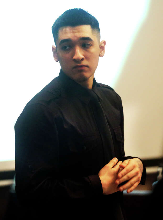 Jacob Gonzales, accused of helping in the stabbing death of Gary Cooper, stands during a break in the  proceedings in the 144th District Court with Judge Pat Priest presiding on February 20, 2014. Photo: For The San Antonio Express-News
