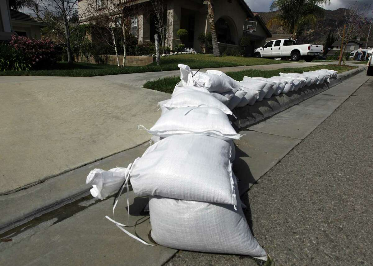Sandbags line a street considered especially at risk in Azusa, Calif., as residents make preparations for possible flooding in advance of a powerful storm.