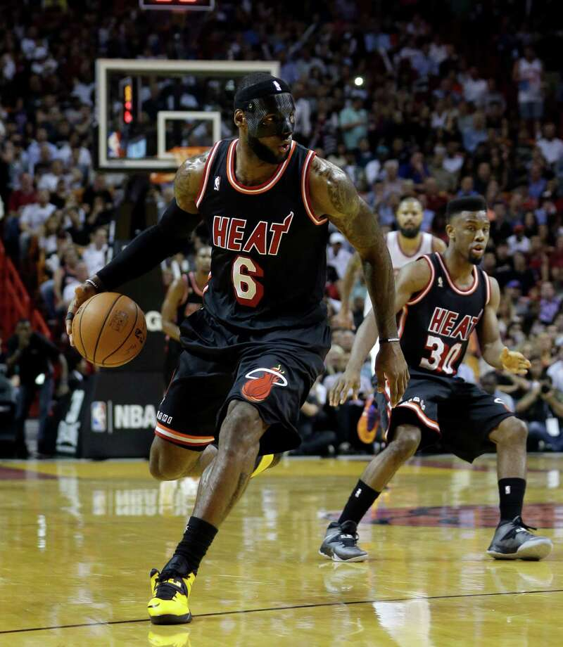 Miami Heat small forward LeBron James (6) drives against the New York Knicks during the first half of an NBA basketball game in Miami, Thursday, Feb. 27, 2014. (AP Photo/Alan Diaz) ORG XMIT: FLAD107 Photo: Alan Diaz / AP