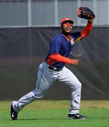 Even though L.J. Hoes has his sights set on starting in right field this season, he says the battle for outfield spots is a friendly one. Photo: Karen Warren, Staff / © 2013 Houston Chronicle