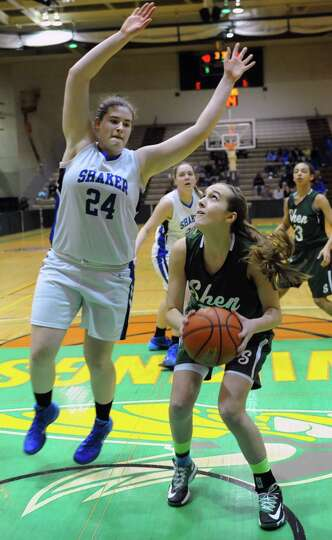 Shenendehowa's Carly Boland waits for Shaker's Becky Rossier to come down before she goes up to make