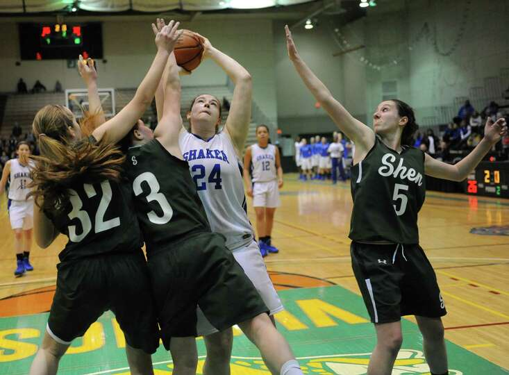 Shaker's Becky Rossier is surrounded by green during the Class AA girls' basketball semifinal agains