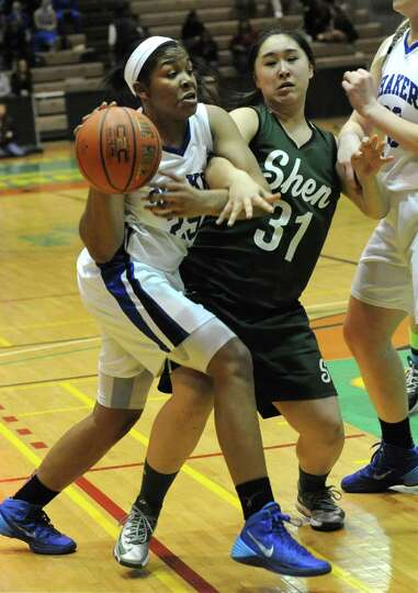 Shaker's Lyric Artis is guarded by Shenendehowa's Amanda Lee during the Class AA girls' basketball s