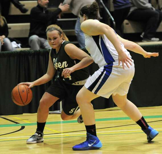 Shenendehowa's Ashely Acker is guarded by Shaker's Becky Rossier during the Class AA girls' basketba